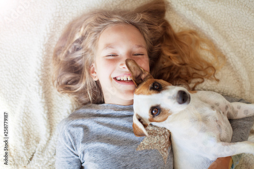 Leinwanddruck Bild Happy child with dog