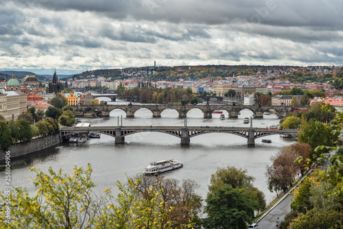 fototapeta na ścianę Gorgeous view on Prague city center, Vltava river and cascade of bridges, Czech Republic. Autumn Prague.