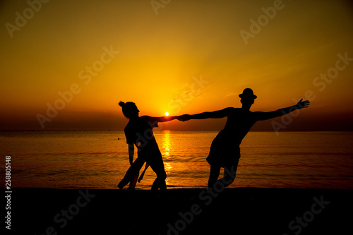 loving couple by the seaside sunset