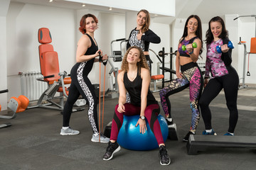 Group of girls training in a gym shot