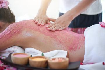 Young woman receiving salt massage in spa salon © manusapon