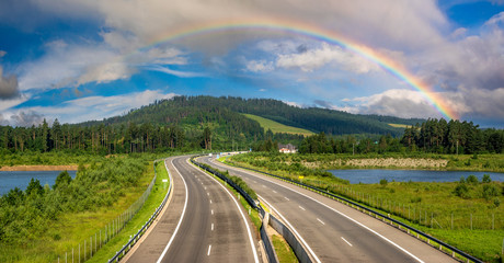 Rainbow over the highway in the mountains