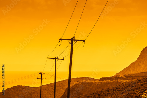 High voltage towers in mountains