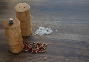 wooden bamboo salt and pepper shaker on a dark wooden background © Ольга Ястребова