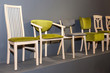 wooden chairs with green upholstered near grey wall