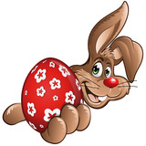 Osterhase rotes Ei in der Hand