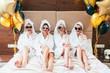 Leinwanddruck Bild - Bathrobe party girls talking on smartphones. Urban females leisure lifestyle. Sunglasses and towel turbans on. Balloons.