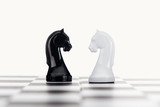 selective focus of chessboard and white and black knights isolated on white