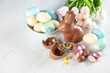 Leinwanddruck Bild - Chocolate Easter bunny and eggs