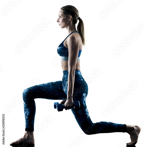 Fototapeten Fitness one caucasian woman exercising fitness weights excercises in silhouette isolated on white background