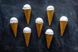 Neat arrangement of seven ice cream cones