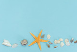 Flat lay of tropical beach summer holiday with beach summer accessories for traveling on blue wooden background - 258933726