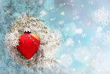 Red christmas decoration heart , on the xmas tree on glitter bokeh background with twinkle lights. Merry christmas card. Winter holiday theme. Happy New Year. Space for text.