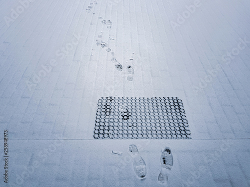 Traces of men's shoes on snow-covered surface