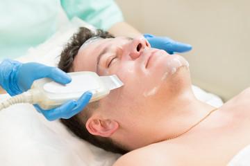 Man in the mask cosmetic procedure in spa salon  © lester120