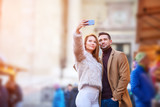 Couple selfie in a christmas market