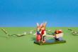 canvas print picture - Osterhasenpaar mit einem Wagen voll Ostereier