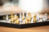 gold and silver pieces on chess board game