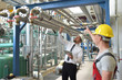 businessman and worker meeting in a factory - maintenance and repair of the industrial plant