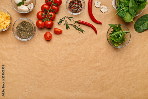 Ingredients and spices for homemade pizza on wooden table - 259009908
