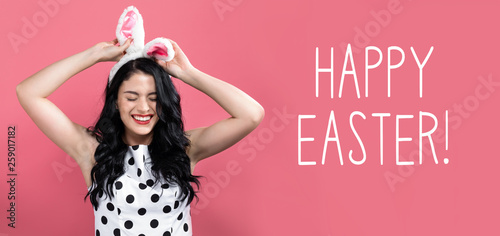 Happy Easter message with young woman with Easter theme - 259017182