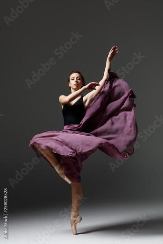 fototapeta na ścianę Young beautiful ballerina is posing in studio