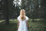 Fototapeta Fototapeta las, drzewa - White dressed woman, alone in magic forest. © robsonphoto
