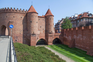 City wall with red brick towers in Warsaw