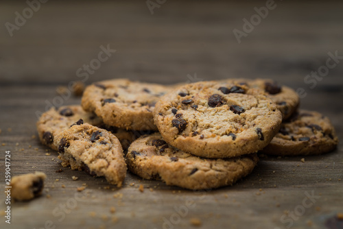 Classic chocolate chip cookies against wooden background. Concept of dessert, baking, and sweet food © Alexandr Vorobev