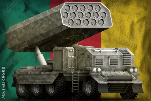 rocket artillery, missile launcher with grey camouflage on the Cameroon national flag background. 3d Illustration © Антон Медведев