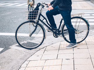 People riding Bicycle city street lifestyle Bike to work at Cross walk