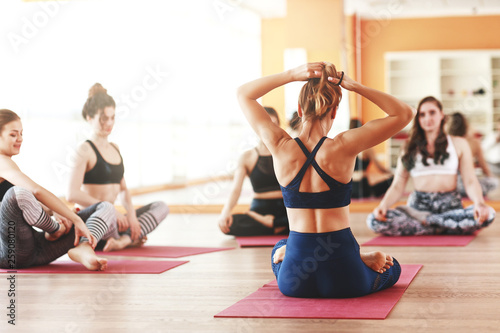 canvas print picture group of people engaged in yoga class meditate in Lotus position