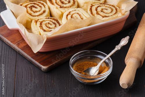 cinnamon buns on a baking sheet © Andrey Cherkasov