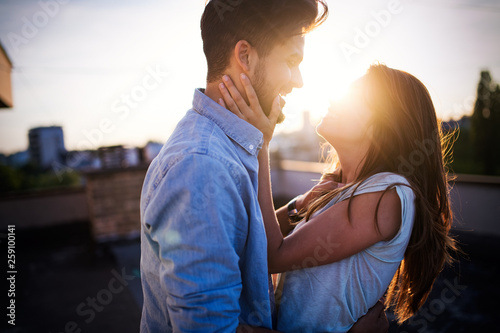 Leinwandbild Motiv Beautiful couple in love dating outdoors and smiling