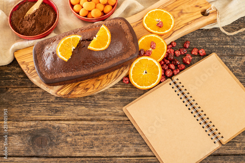 Cake with chocolate , cocoa , flour and hazelnut on the rustic wooden table © studio GDB