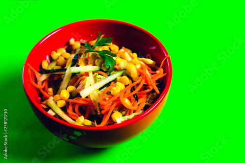 fresh carrot and corn salad in a red plate - 259121730