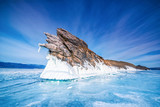 Tail of Ogoy island with natural breaking ice in frozen water at Lake Baikal, Siberia, Russia.