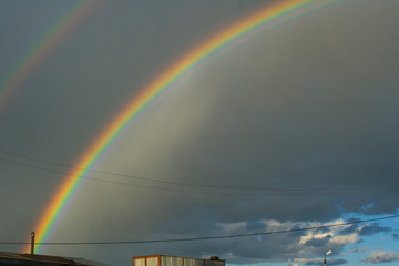 Rainbow in the sky. Weather after rain. All colors of the rainbow. Beautiful nature. Weather forecast.