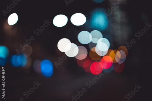 Abstract bokeh lights in city blurred night background - 259143547