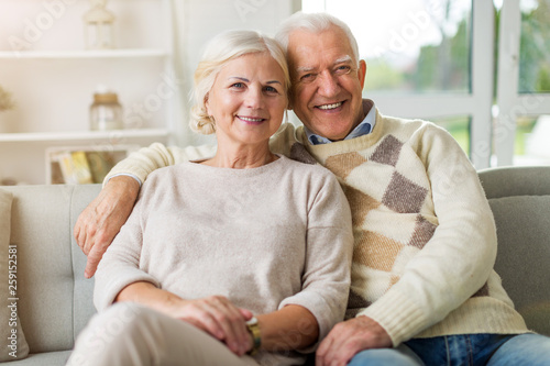 Happy senior couple at home - 259152581