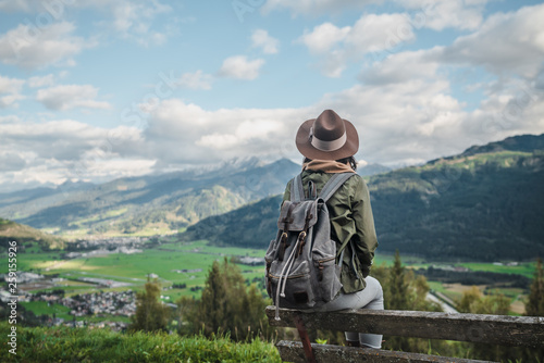 Leinwanddruck Bild Young woman with a backpack outdoors