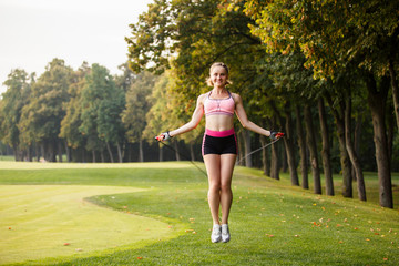 sport girl making exercises outdoors. Young sport woman in a park. Sport and fitness on open air. Exercise lunge leg on the grass and stretching