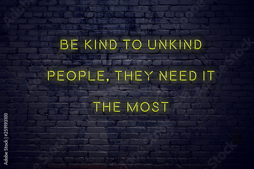 canvas print picture Positive inspiring quote on neon sign against brick wall be kind to unkind people they need it the most