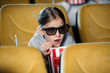 selective focus of frightened child in 3d glasses watching movie and eating pop corn