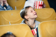 cute upset child crying while watching movie in cinema
