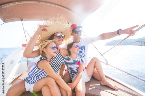 family on sea yacht