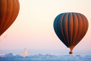 Hot air balloons fly over Bagan temples