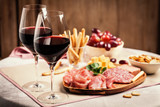 Red wine with charcuterie and cheese
