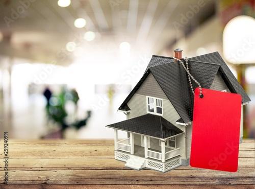 Leinwandbild Motiv Classic house model on blueprint on white background