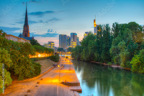 Sunset view of skyscrapers in frankfurt viewed behind church of three kings, Germany - 259245531